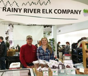 Willian Darby and his daughter at the Rainy River Elk booth